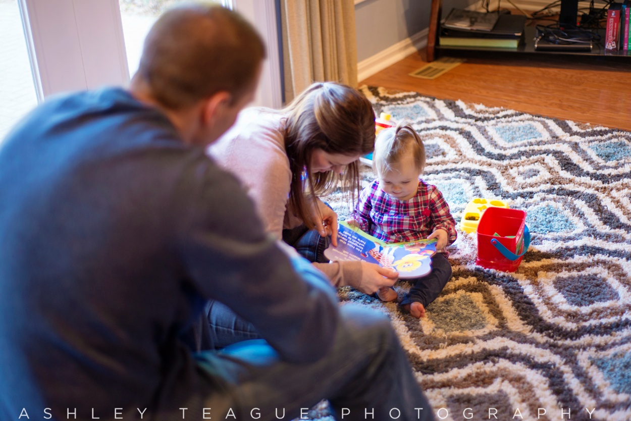 Parents Reading to One Year Old Girl