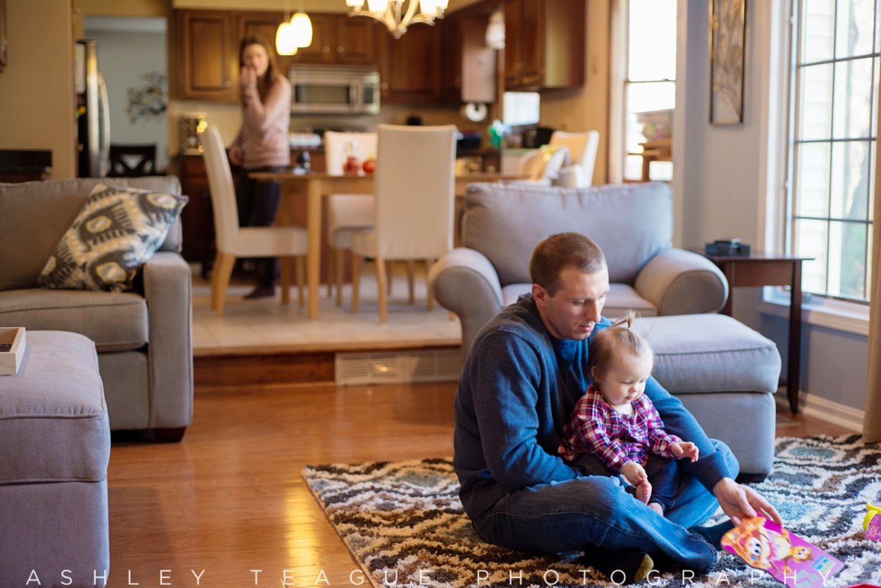 Young Parents at Home with Baby Girl