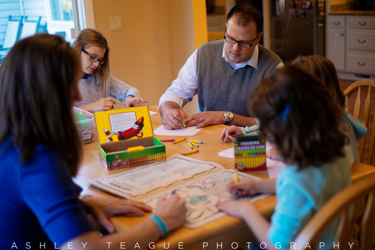 Dad Coloring With Daughters