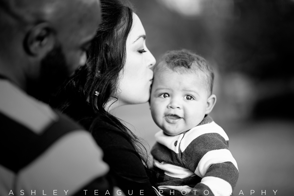 Mom Kissing 6 Month Old Boy Outside