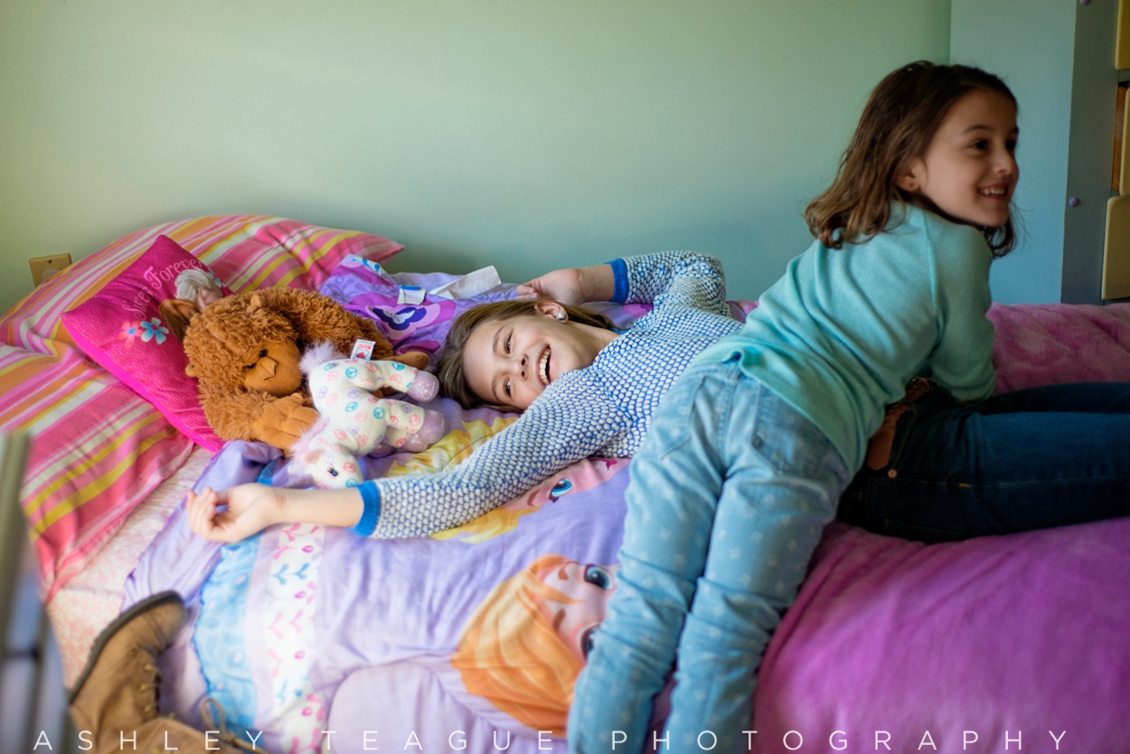 Young Sisters Playing At Home
